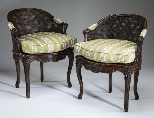 (2) Louis XV style cane back bergeres, 33
