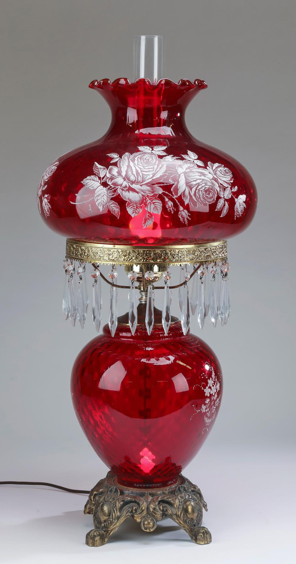 "Ruby glass hurricane style table lamp, 32""h"