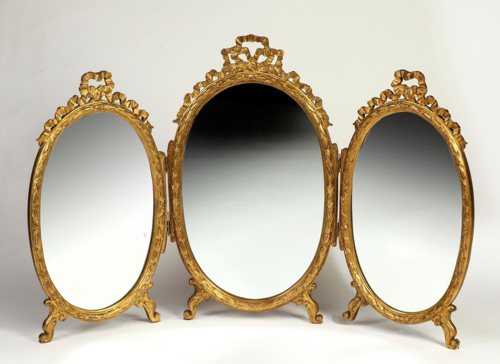 "Continental Rococo style giltwood vanity mirror, 63""w"