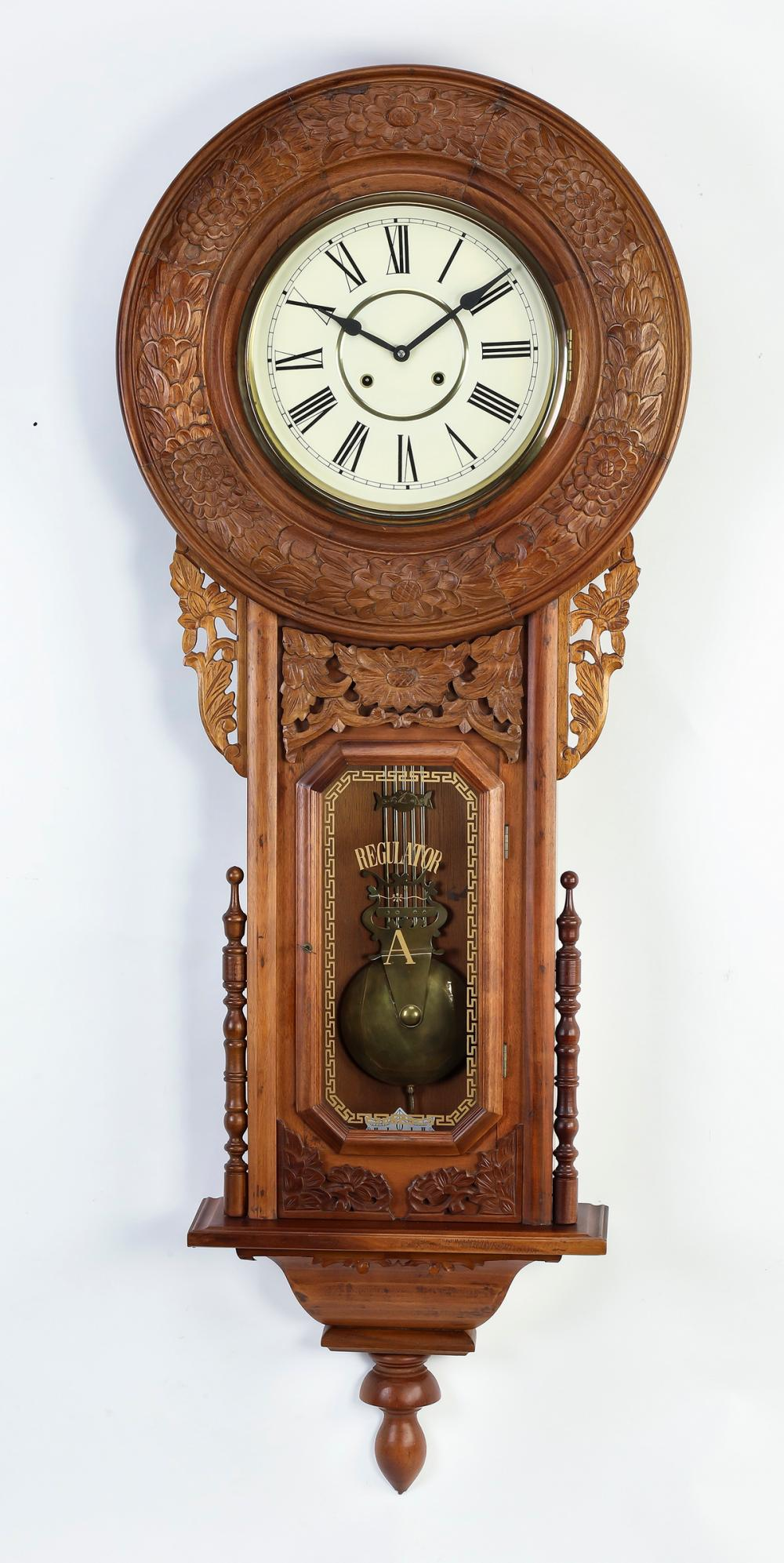 American regulator clock with carved bezel