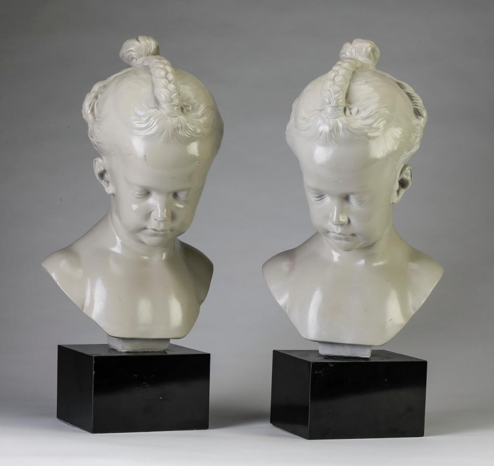 "Pair of female child busts with braided hair. 19""h"