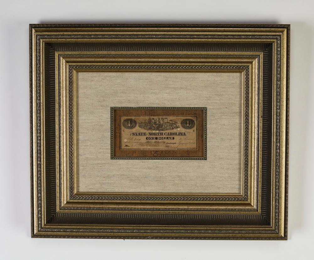 Obsolete Confederate $1 currency note, framed