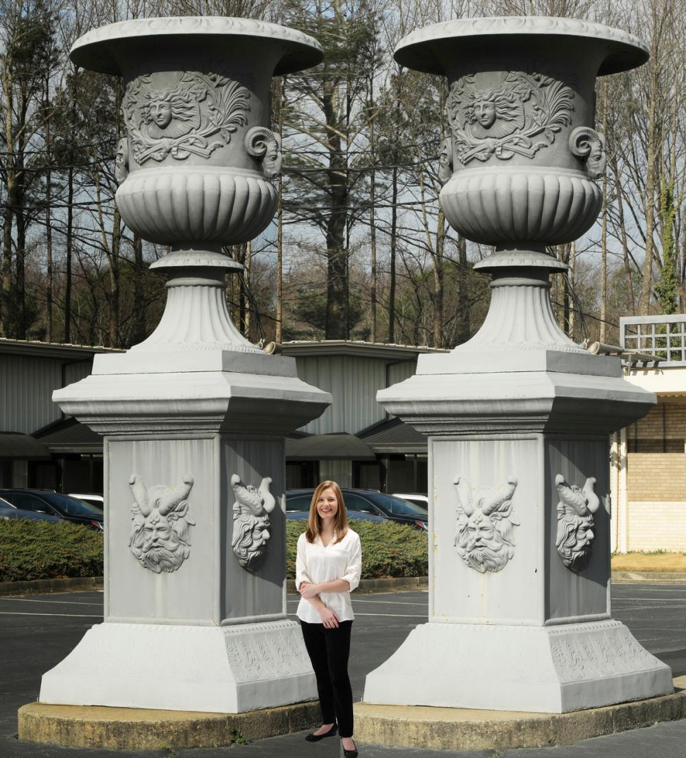 Monumental cast iron urns on pedestals, 12.5 ft tall