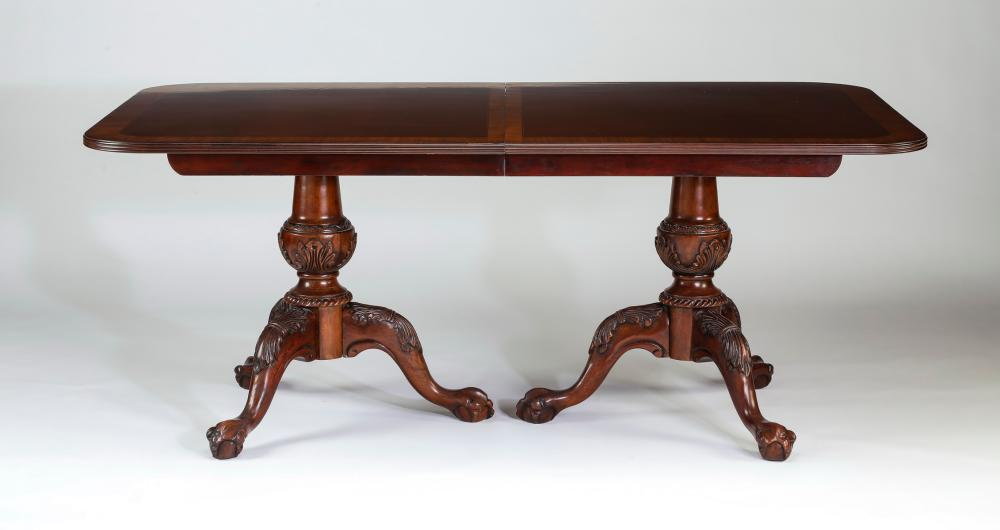 Chippendale style mahogany dining table w/ leaf