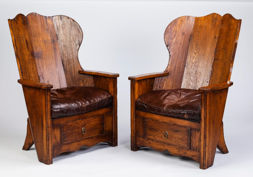 Pair of English oak and leather lambing chairs
