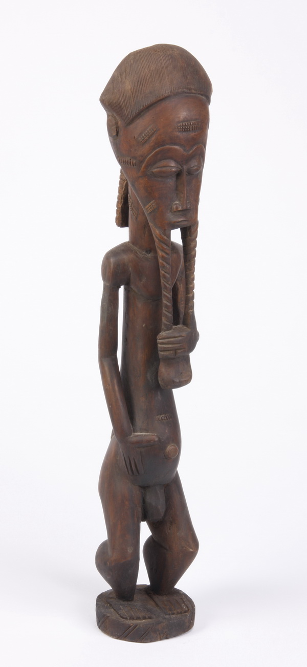 Carved figural sculpture from western Africa, 34