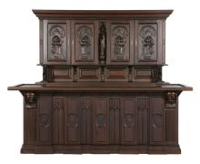 Gothic Revival carved oak front and back bar