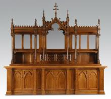 Gothic Revival style carved oak buffet, 144