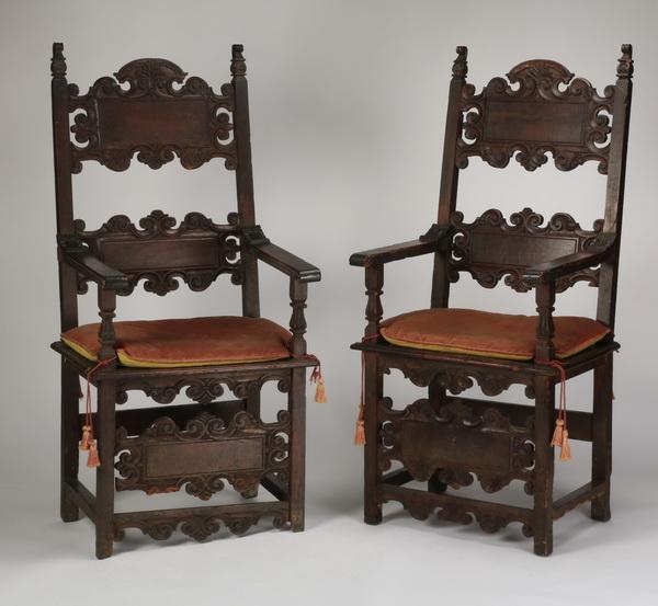 (2) 19th c. Italian carved oak armchairs
