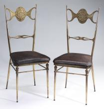 (2) Mid-century brass chairs w/ hair on hide seats