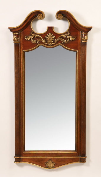 Carved and parcel gilt mahogany mirror, 54
