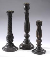 Group of (3) wooden candle holders of varying heights