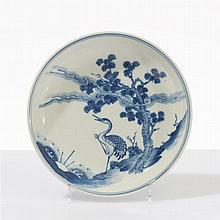 Coupe  Porcelaine émaillée bleu blanc à décor d'un échassier, Chine, ma
