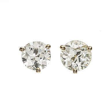 Clous d'oreilles sertis de diamants taille ancienne (env. 1.3 ct) retenus par trois griffes
