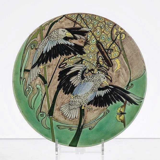 Grand plat rond à décor d'oiseaux en vol et roseaux, Purmerend