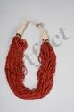 Collier de guerrier coupeur de têtes composé de multi rangs de petites perles de pate de verre couleur corail sur textile crocheté. Nagaland. Inde.