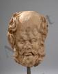 Tête d'ascète au crâne chauve prohiminant, des boucles partant de chaque côté et la barbe en broussaille.  Terre cuite. Art Gréco Bouddhique du Gandhara. Afghanistan. 2 ème à 3 ème siècle. Ht 15 cm