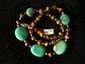Collier ethnographique recomposé selon la tradition de perles de turquoise, aeil de tigre et métal argenté. Tibet.