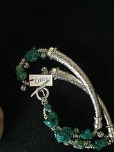 Collier recomposé selon la tradition de perles de turquoise et métal argenté.  Tibet.