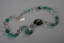 Collier ethnographique recomposé selon la tradition de perles de cristal de roche, turquoises himalayennes et métal argenté. Ladakh.