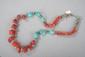 Collier recomposé selon la tradition de perles de turquoise, corail et métal argenté. Mongolie.