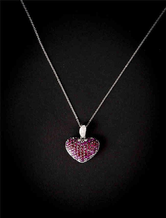 A multi gem and gold pendant and chain with pink sapphire and diamonds.