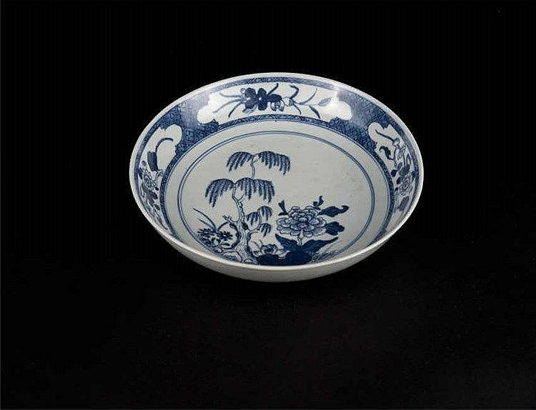 A blue & white dish, painted on the interior with a tree and flower blossoms; the exterior in underglaze white; Qing dynasty
