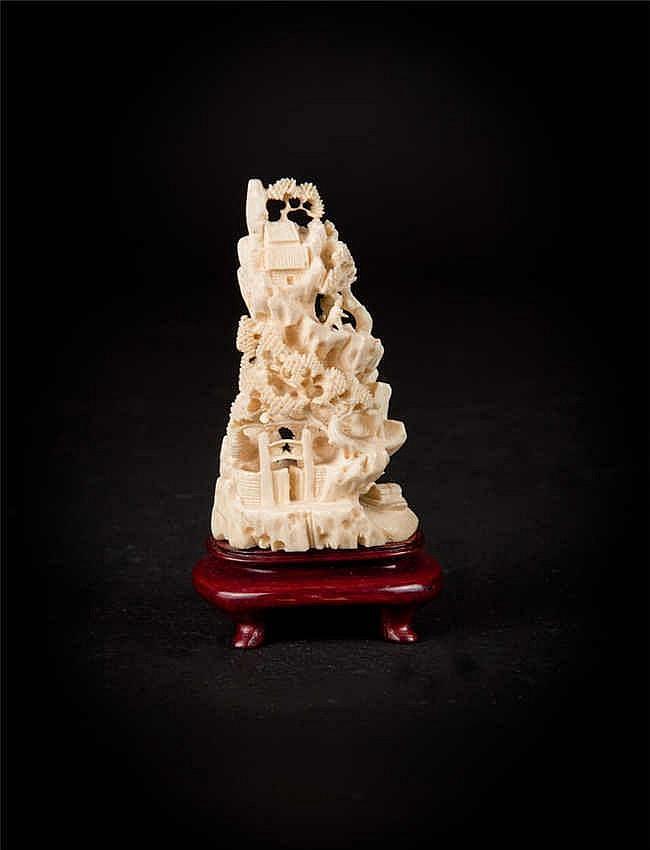 A Cultural Revolution Carved Ivory Boulder with Figural Landscape 象牙文革雕山水人物山子摆件 高 (Height):16.8cm