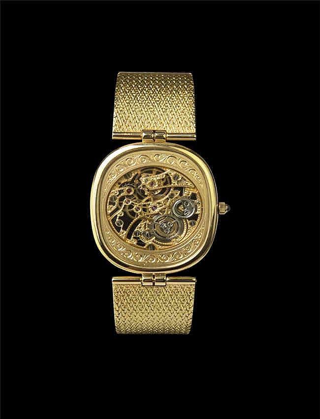 Patek Philippe 18K Gold and Diamond – set oval Skeletonised Wristwatch. Manual. Limited edition. Ref: 3881/001 18K 百达翡丽黄金 手动上弦腕表镂空机芯设计 . 18K黄金表壳,表壳6点和12点位置镶有钻石;蓝宝石镜片及底盖;表冠镶有一颗黑色宝石.