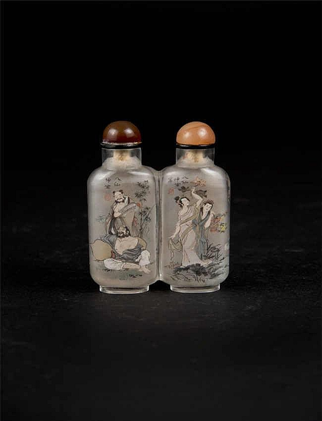 An inside painted snuff bottle with vibrant colours depicting the Eight Immortals, signed by Liu Kun Yan.