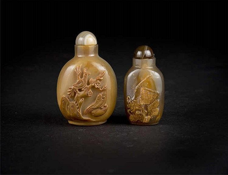 Two agate snuff bottles: one carved with birds on a tree; the other carved with a grasshopper. Both in brownish hues. Qing dynasty
