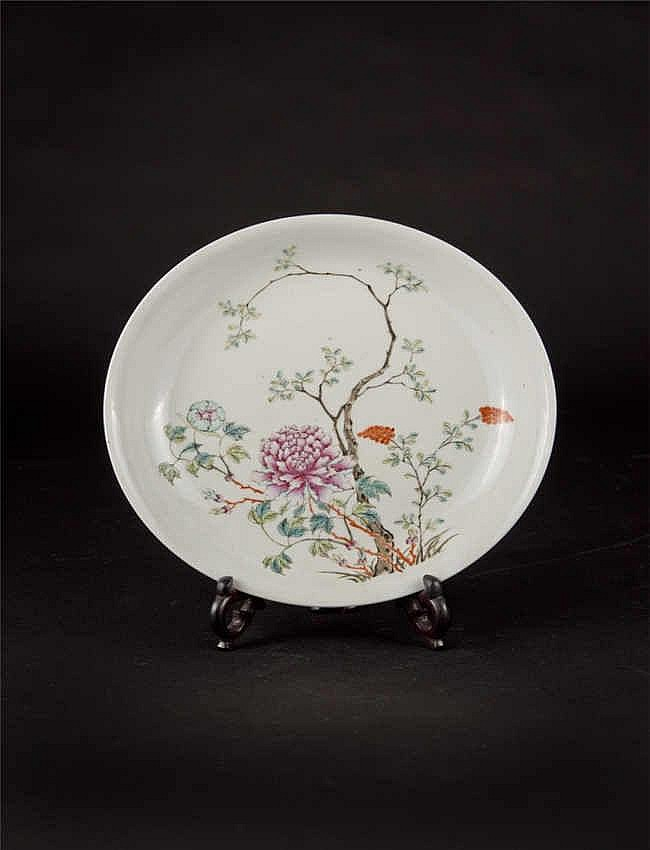 A famille rose dish finely decorated with tree peony in vibrant colours; Qing dynasty/Republic period. Rosewood stand and box