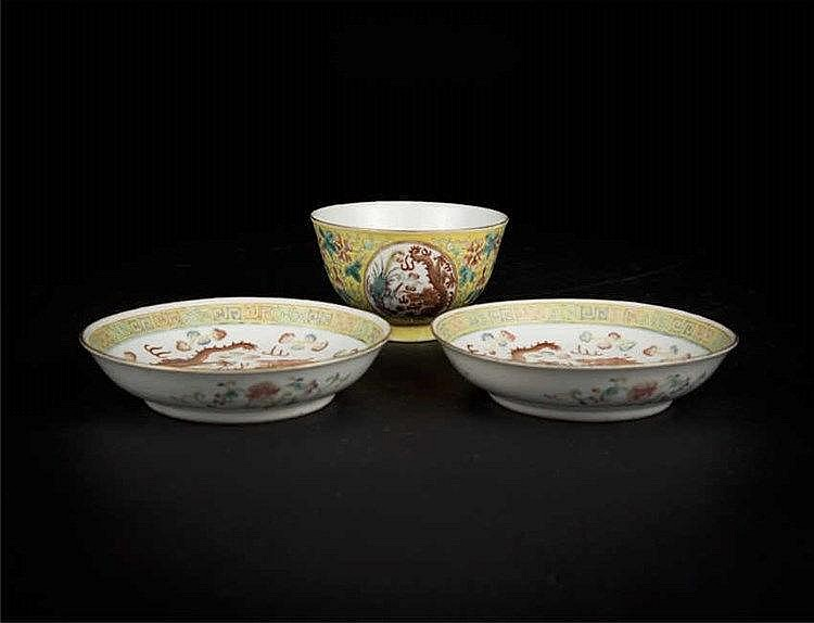 "A famille-rose ""dragon and phoenix"" medallion bowl, with six-character Guangxu mark in underglaze blue and of the period; and a pair of famille-rose dragon dishes, with iron-red six-character Guangxu marks and period."