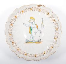 A Delft polychrome shallow dish, with a child baptist, English, late 17th C