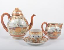 Japanese eggshell part tea service decorated with geishas.