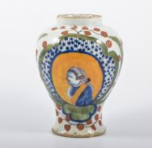 A Delft vase-shaped jar, painted with a profile portrait WF, 15cm.