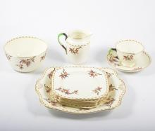 A Tuscan bone china half teaset, decorated with branches.