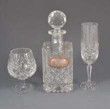 A lead crystal decanter with silver whisky label, four Stuart brandy balloo