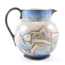 William Moorcroft, Fish, a large salt glazed jug, circa 1930, decorated wit