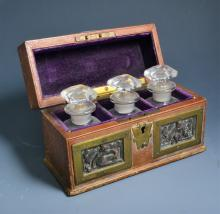 Late 19th century Continental leather bound casket containing three glass s