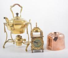 Assorted copper and bass ware, including a spirit kettle, clock, beaten tra