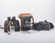 Vintage cameras and accessories, quantity in one box.