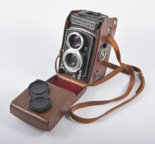 A Rolleicord DBP Va twin lens camera in original leather case.