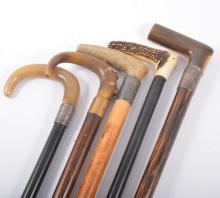 Ebony walking stick, horn handle, silver ferrule, 93cm and four other walki