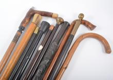 A Malacca cane, with a horn pommel, 92cm, a collection of walking sticks, (