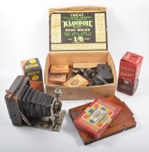 Box containing movie reel films, camera equipment, valves, light bulbs, etc