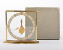 A lacquered brass inline mantel clock, No. 320, 16cm, in a Jaeger LeCoultre