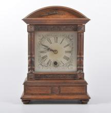 A German walnut cased mantel clock, silvered dial, spring driven eight day
