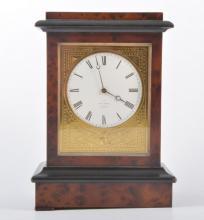 Two mantel clocks, a mahogany cased three train Napoleon style clock with a
