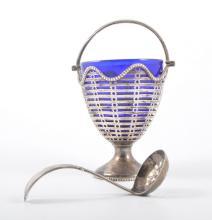 A silver pedestal sugar basket, pierced design with bead edge rim and handl